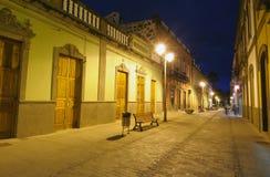City street illuminated at night Royalty Free Stock Photography