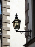 City street lamp on the wall of a stone house. Royalty Free Stock Image