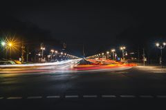 City street with light trails at night. Long city street with light trails at night. Long exposure photo of straight wide road in Berlin Royalty Free Stock Images