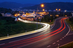 The city with street lighting in the valley at night, the light path headlights of cars Stock Images