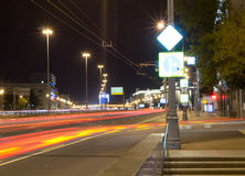 City street with lights and traffic at night. background, city life. Royalty Free Stock Photos