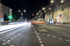 City street with lights and traffic at night. background, city life. Stock Images