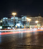 City street with lights and traffic at night. background, city life. Stock Photos