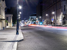 City street with lights and traffic at night. background, citylife. Royalty Free Stock Photo