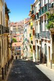 City street in Lisbon Portugal. A view down a narrow, quaint street in Lisbon, Portugal royalty free stock photo