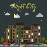City street at night. Cars and buildings in Royalty Free Stock Photo