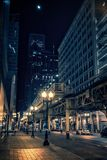 City street at night in Chicago`s Loop with train station. City street at night in Chicago`s Loop with elevated train station, illuminated buildings, cars and Royalty Free Stock Photography