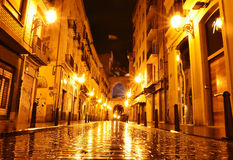 City street in night, Valencia, Spain Stock Images