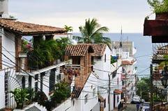 City street in Puerto Vallarta, Mexico. Street leading to Pacific ocean in Puerto Vallarta, Mexico Stock Photos