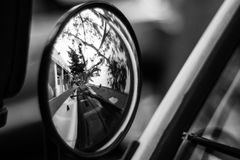 City street reflected on a car mirror. Black and white photo Royalty Free Stock Photography