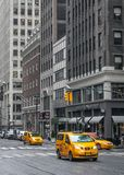 City street scene with a yellow taxi cabs stock photo