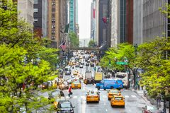 City street scene with a yellow taxi cabs stock image