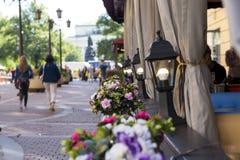 City street, St. Petersburg, flower pots ,street lamps, people w Stock Photography