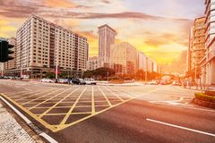 City street view with modern buildings in Macau. At daylight Stock Photos