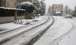 City street with white snow during a winter snowfall Royalty Free Stock Images