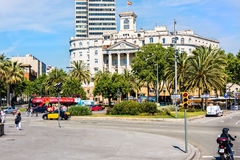 City Streets in Barcelona. Barcelona, Spain - June 6, 2016:  City streets and pedestrians near The Naval Sector of Catalonia, a government building which Stock Photos