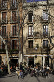 City Streets in Barcelona,Spain. Terraces filled with people enjoy the afternoon sun stock image