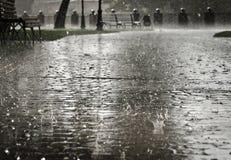 City streets during heavy rain. Royalty Free Stock Image