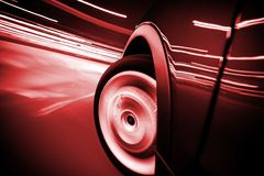 City Streets Ride Car in Motion. City Streets Ride with Motion Blur and Reddish Color Grading. Car in Motion Royalty Free Stock Photo