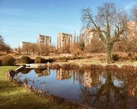 City structures reflected in park pond Stock Photo