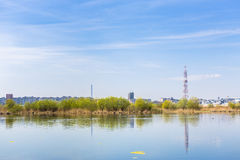 City suburbs and lake royalty free stock photography