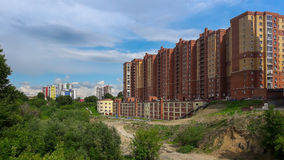 City summer landscape against the blue sky. Ravine in the foreground Stock Image