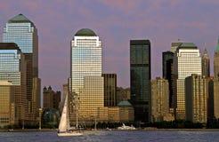 City at Sundown. Sun setting on New York City stock images