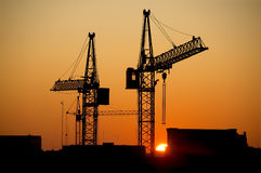 City sunrise. Industrial silhouettes at warm sunrise Stock Images