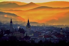 City sunrise over mountain Stock Photography