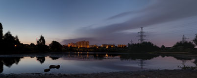City sunrise over pond. In panorama Royalty Free Stock Images