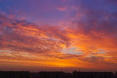 City sunrise, red clouds Royalty Free Stock Image