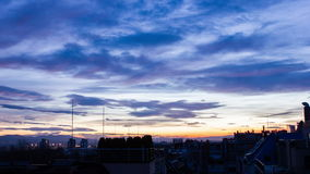 City Sunrise. Timelapse of the sky filled with clouds at sunrise in an urban city environment stock video