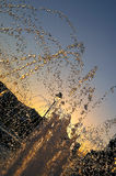 City sunset. Fontana water drops  little blurred in sunset Royalty Free Stock Photography