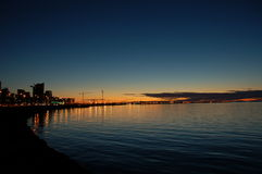 City sunset. Reykjavik evening view from city beach Stock Images
