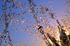 City sunset #2. Fontana water drops little blurred in sunset stock image
