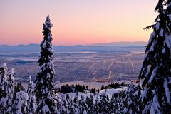 City at sunset from Grouse Mountain. Winter. stock images