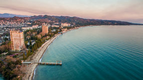 The city during sunset from a height. Flying quadcopter over night city Stock Images