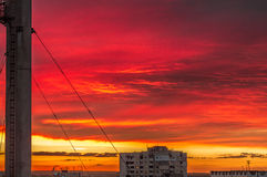 City sunset. Red sky house red sun clouds beautiful high quality Stock Photos