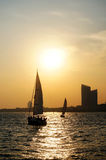 City sunset sailboat. Seaside at qingdao Stock Images