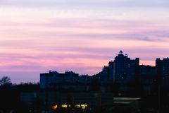 City in sunset time, Silhouettes of houses in the evening haze, In purple. And rose tones, evening cityscape Stock Photography