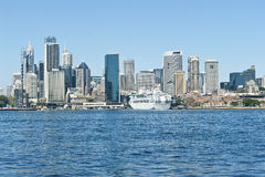 City of Sydney. View acroos the harbour to the city of Sydney with the cruise ship Dawn Princess berthed at the Overseas passenger terminal 16th March 2012 royalty free stock images