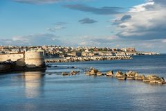 Syracuse from the Ortygia Island - Sicily Italy. The city of Syracuse Siracusa seen from the Ortygia Island Isola di Ortigia with the Mediterranean Sea. Sicily Royalty Free Stock Photography
