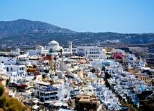 City on the terraces. Like snow on top of a mountain of Santorini, situated white city. This man-made miracle every year attracts thousands of tourists Royalty Free Stock Photography