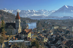 The city of Thun, the lake and the mountains royalty free stock photos