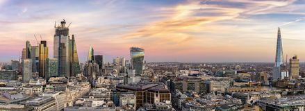 From the City to the Tower Bridge, just after sunset. Panoramic view over the modern skyline of London: from the City to the Tower Bridge, just after sunset royalty free stock photography