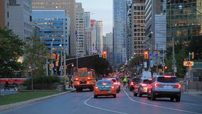 City of Toronto at dusk. Toronto, Canada - Oct 20, 2017: Busy street in the city of Toronto at dusk. Province of Ontario, Canada