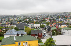 City of Torshavn in Faroe islands. Aerial view over the city of Torshavn in Faroe islands on a foggy day Stock Images
