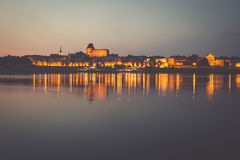 City of Torun in Poland, old town skyline by night from Vistula royalty free stock photography