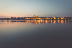 City of Torun in Poland, old town skyline by night from Vistula Royalty Free Stock Photos