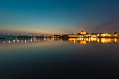City of Torun in Poland, old town skyline by night from Vistula Stock Photography